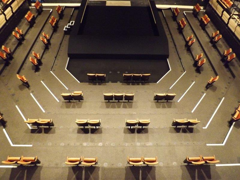 Picture of the Bridge Theatre auditorium with seats removed for social distancing – angle 2